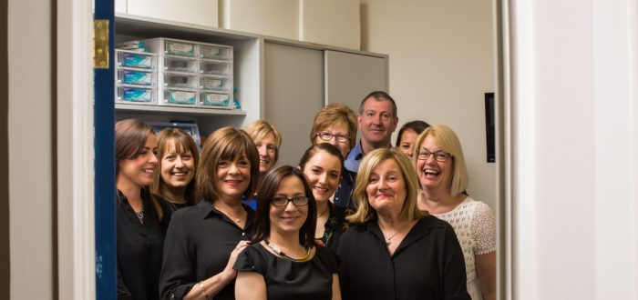A G Marshall Optometrist staff posing before move.